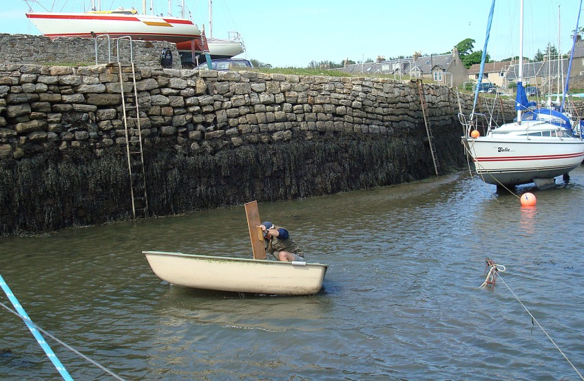 into the water, retrieving dinghy